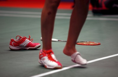Spain's Carolina Marin walks on the court after receiving treatment for an injured foot during her women's singles badminton match with Taiwan's Pai Yu-po at the BWF World Championship in Jakarta, Indonesia August 13, 2015. REUTERS/Darren Whiteside